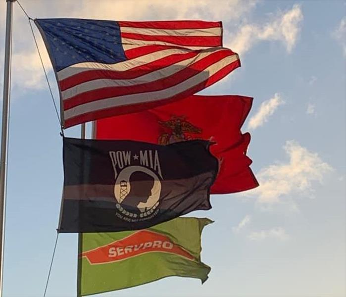 Flags blowing in the wind at SERVPRO warehouse.